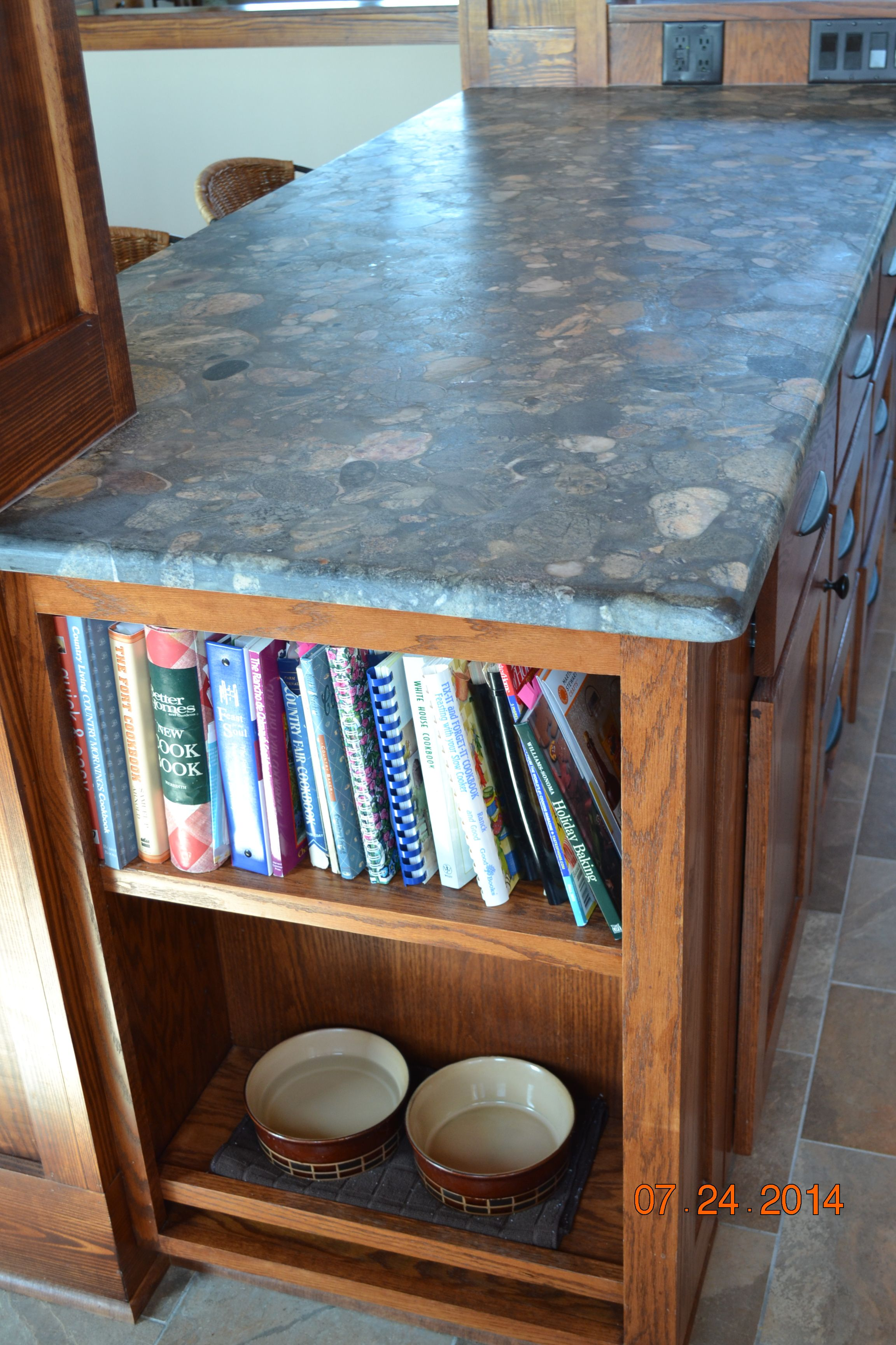 Verde Marinace honed granite island with cookbook storage and doggie ...