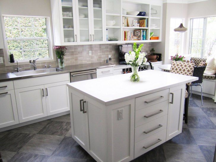 Small Gray Tile Back Splash With White Wooden Cabinet Having Glass Door Beside Glass Windows And Low Cost Kitchen Cabinets Kitchen Wall Cabinets Kitchen Design