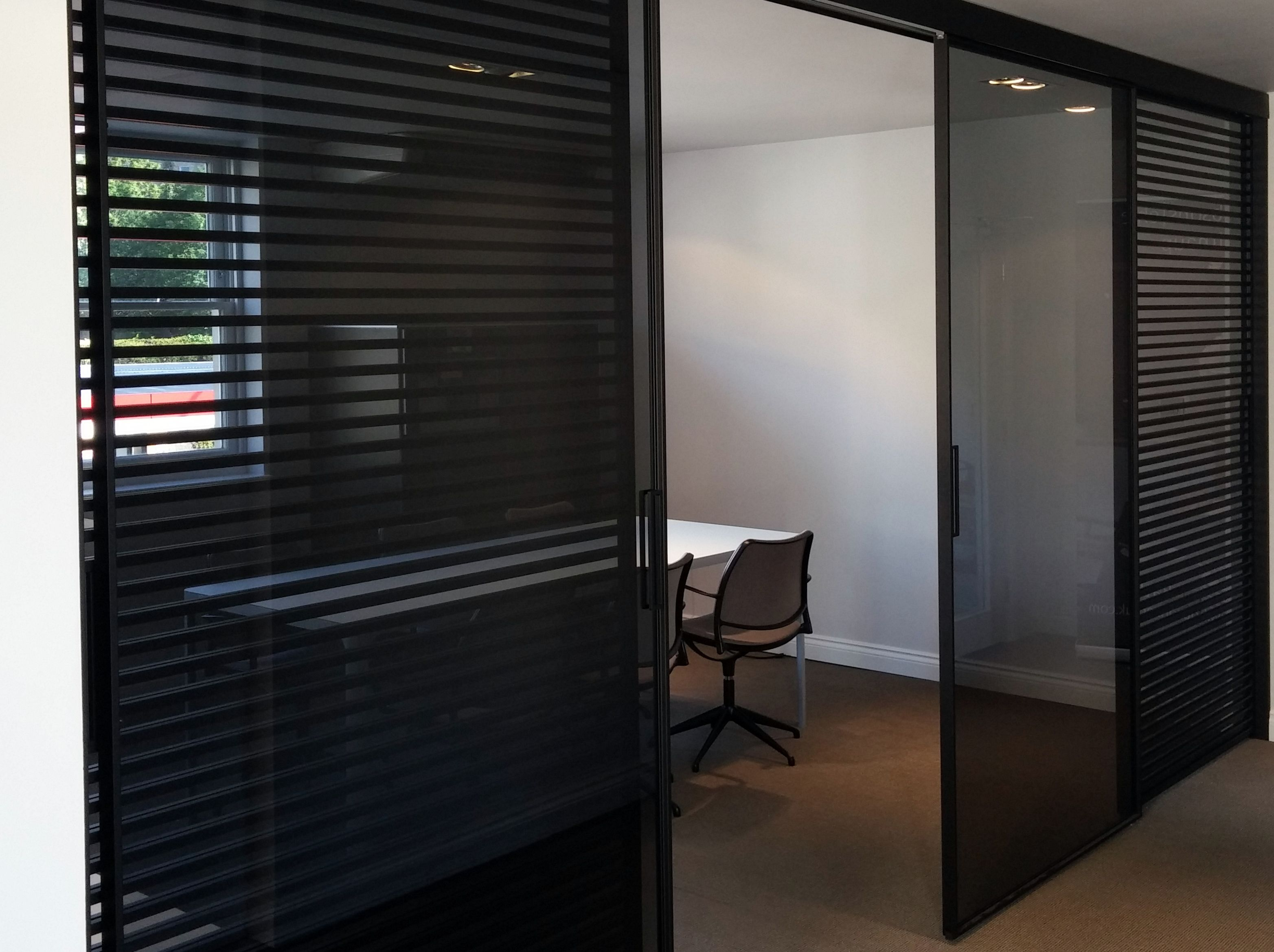 rimadesio stripe glass sliding doors dividing the presentation space from the design studio at. Black Bedroom Furniture Sets. Home Design Ideas