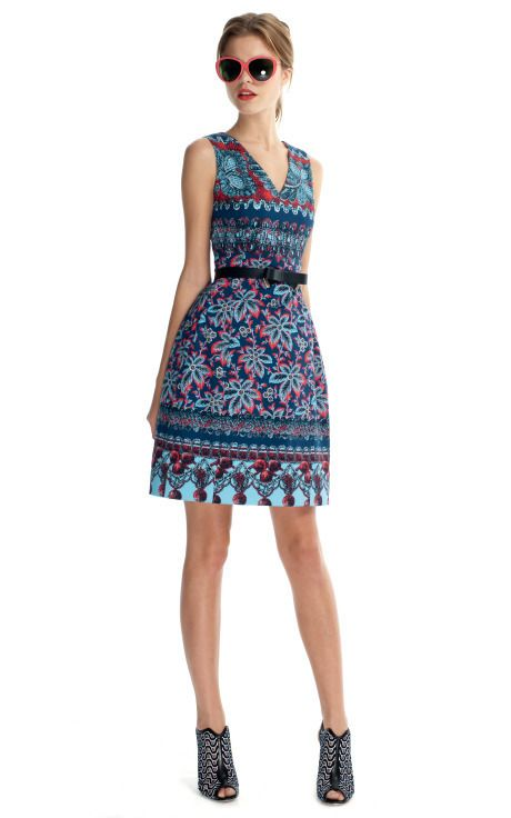 439de9e4c0bdb This sleeveless, two pocket v-neck cocktail dress is cinched at the waist  and