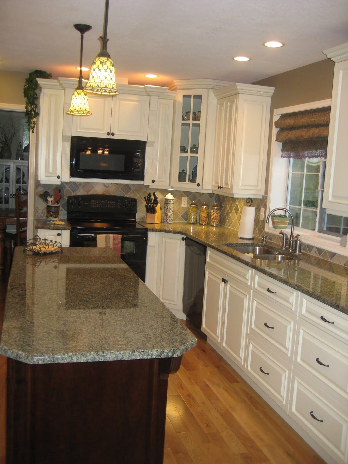 White cabinets with slate backsplash this is it except i for Small kitchen granite countertops