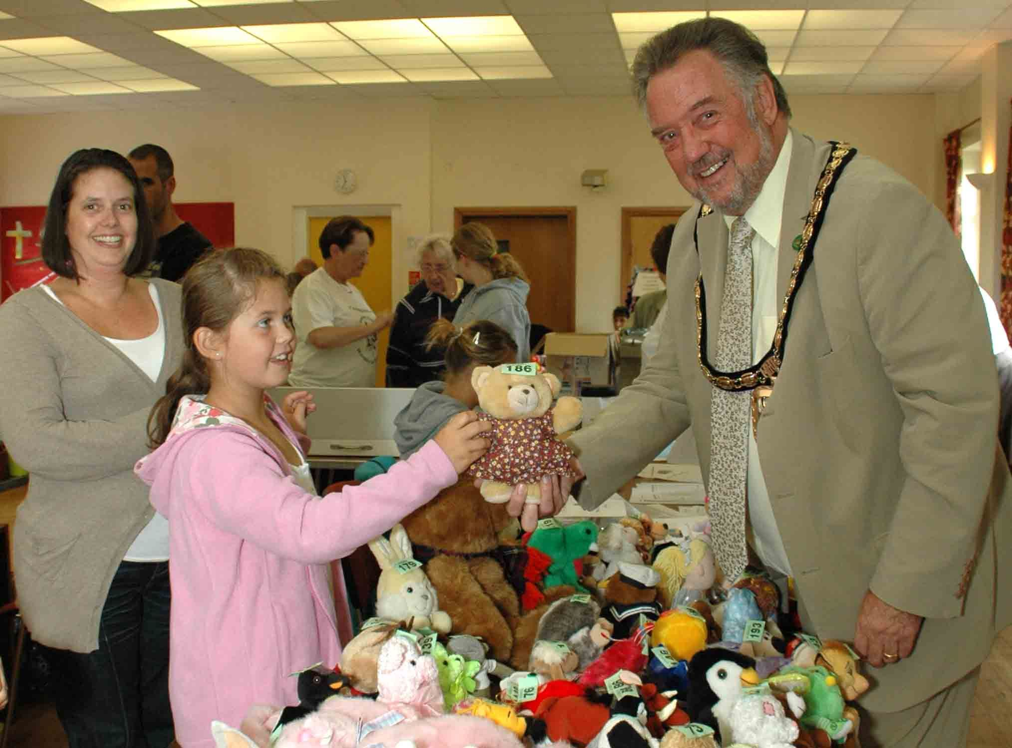 The Mayor of Havant, Councillor Ken Smith rehomes a Teddy Bear at the Rosemary Foundation Roadshow