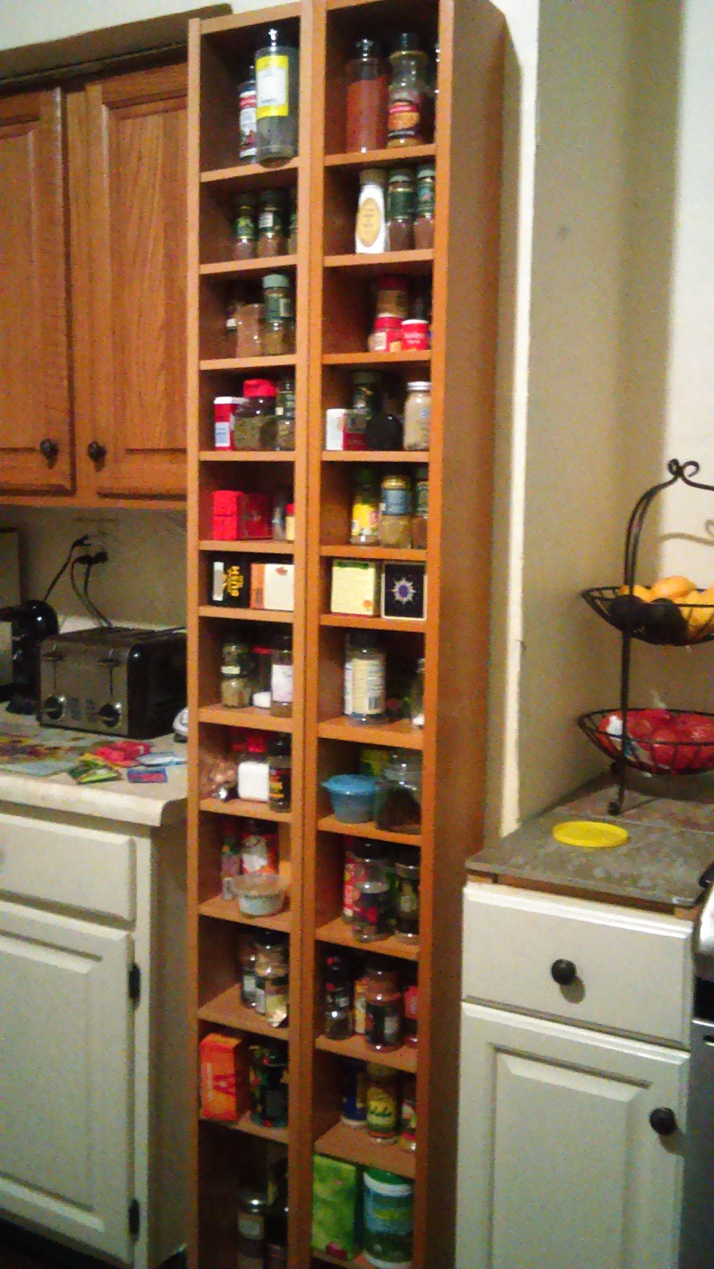 Ikea CD rack used as a spice rack in my kitchen