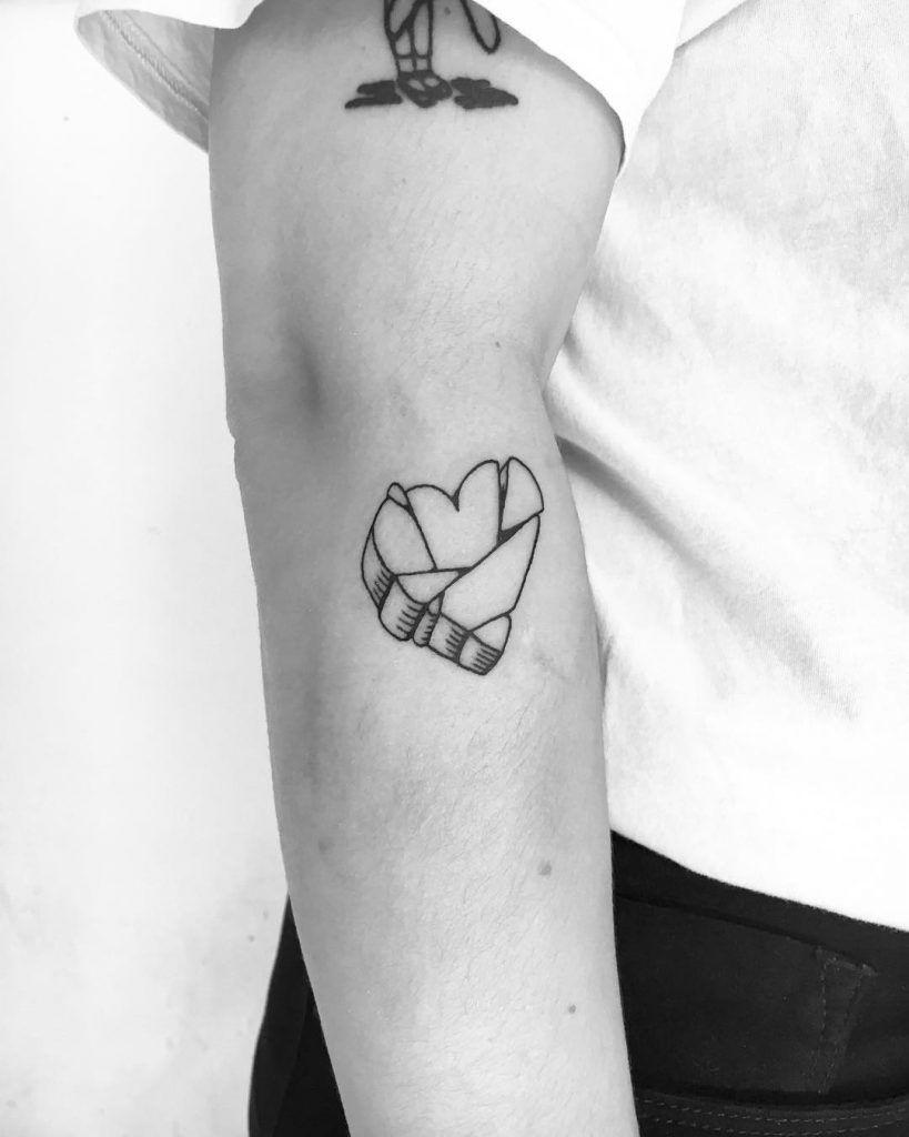 Broken stone heart tattoo inked on the right forearm