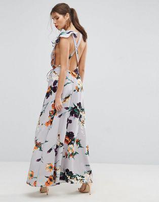 Compra Vestido largo con diseño cruzado en la espalda, estampado floral y  volante asimétrico de ASOS en ASOS. Descubre la moda online.