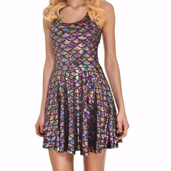Mermaid scale holographic dress is flirty and fun, stretchy and sexy! This dress will surely make a splash with sparkle and shine. It will sure make you feel and look magical. Combine with your favori