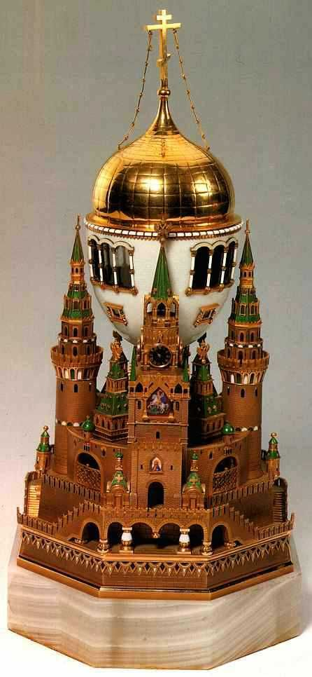 """The """"Moscow Kremlin"""" Fabergé Egg: Presented by Nicholas to Alexandra in 1906. By far the largest of the eggs, it was inspired by the Cathedral of the Assumption (Uspenski) in Moscow, where all the Tsars of Russia were crowned. The surprise is music. The base of the egg contains a gold music box that plays two cherubim chants, traditional Easter hymns can be played when a clockwork mechanism is wound up by a gold key. One of the hymns is the """"Izhe Khveruviny,"""" a favorite hymn of Nicholas II."""
