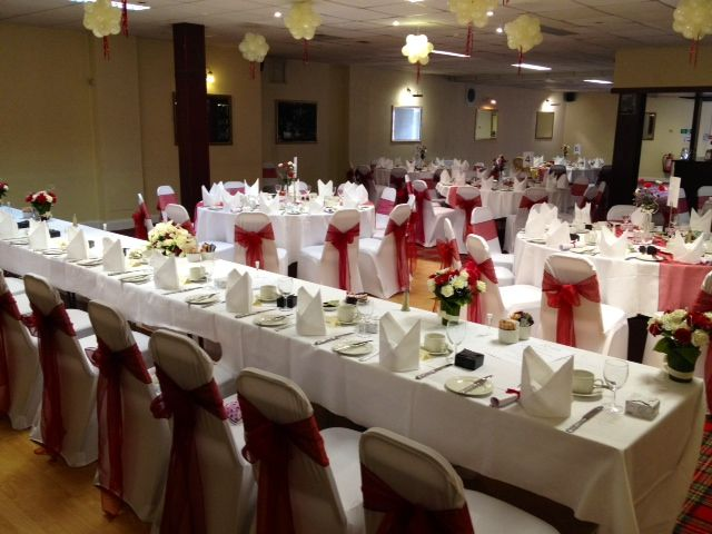 Wedding tables set up red theme at Grampian Hotel