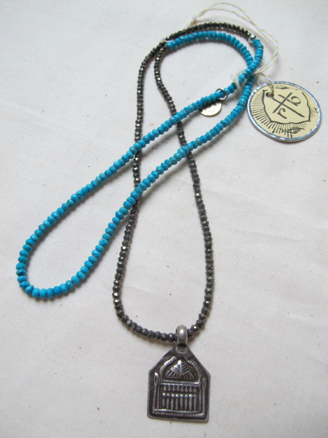 Necklace with Antique Indian Silver Amulet of The Seven Sisters with Shiva and Faceted Turquoise and Silver Pyrite. $129.00, via Etsy.