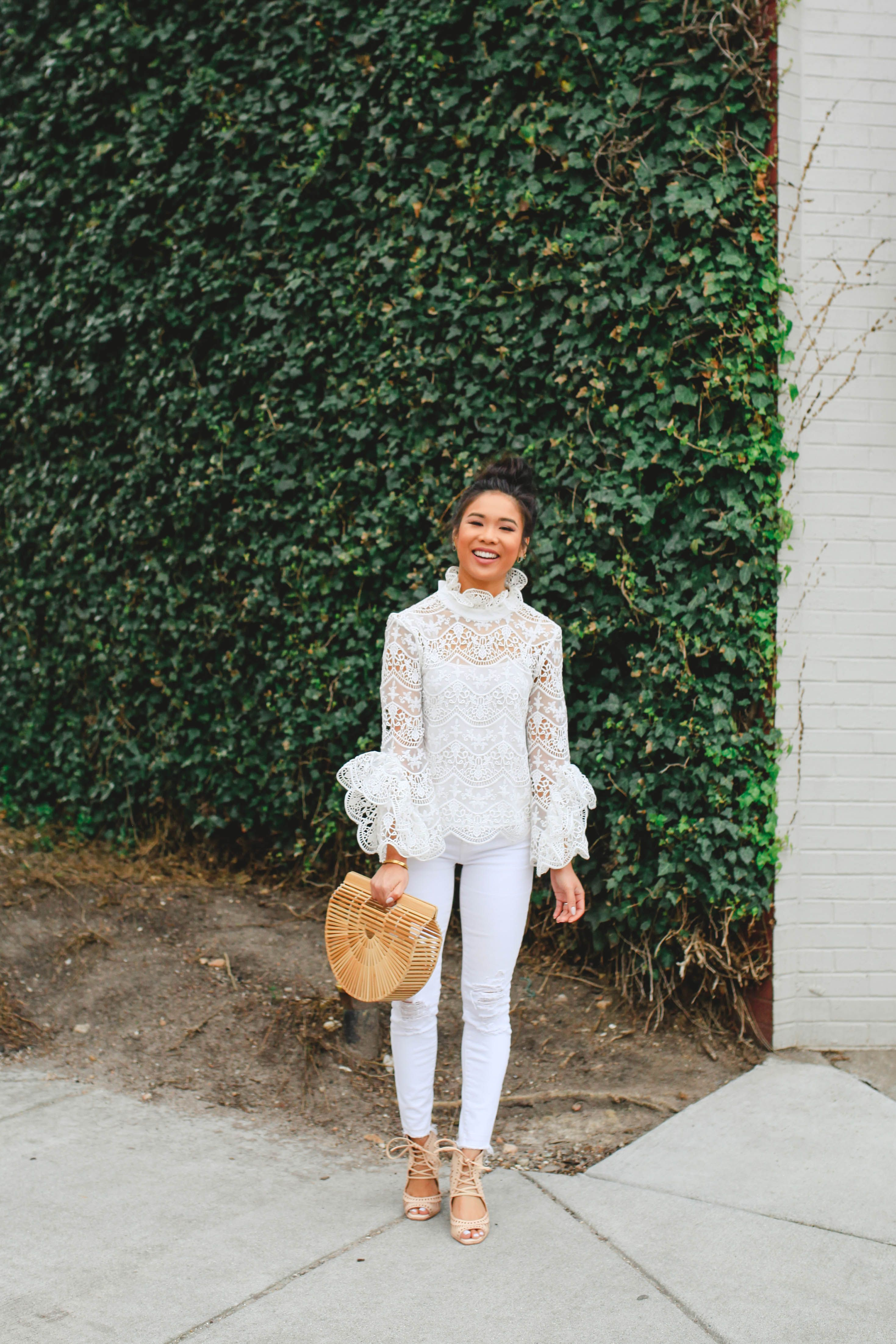 6963eadc078 Hoang-Kim Cung wears a lace crochet top with white jeans and Cult Gaia Ark  bag