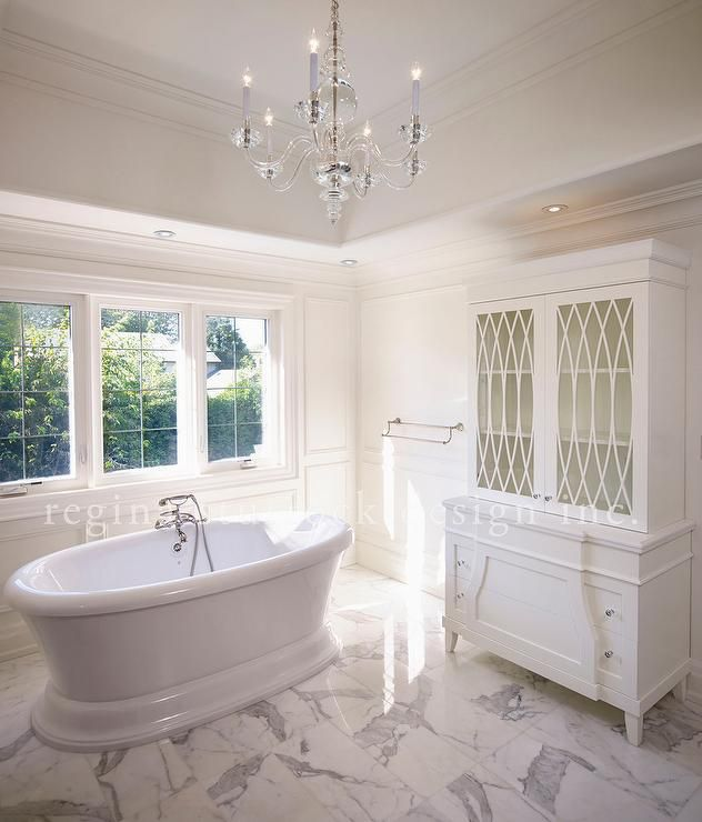 Sophisticated Bathroom Features A Tray Ceiling Accented With A Clear Glass Chandelier, George II