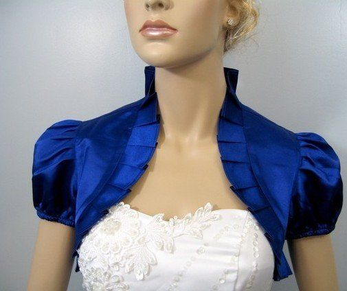 Blue shrug with puffy shoulders
