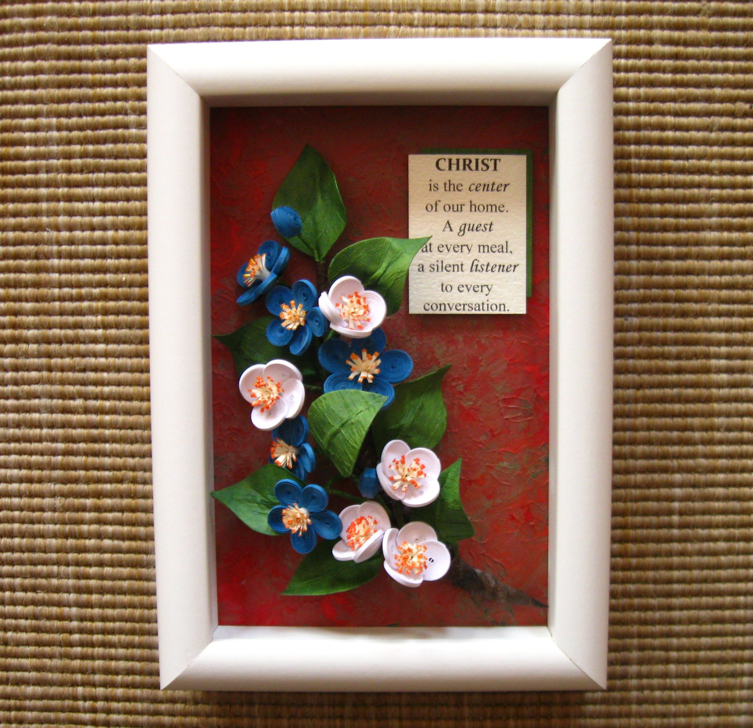 Quilled branch of blue and white flowers (on a 11.8x16.8 cm frame)