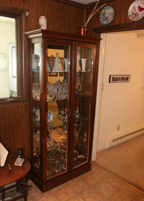 Mirrored Back Curio Cabinet Having Two Doors Four Glass Shelves And
