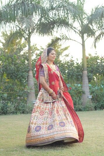 A traditional Bridal lehenga with beautiful peacock embroidery.