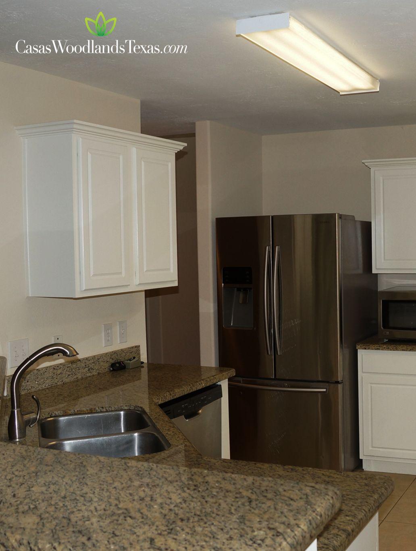La cocina est equipada con gabinetes de madera encimeras - Casas de electrodomesticos ...