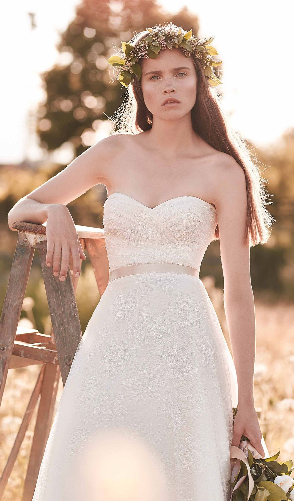 Wedding dress with removable train  Try this Mikaella embroidered tulle wedding dress Crossover