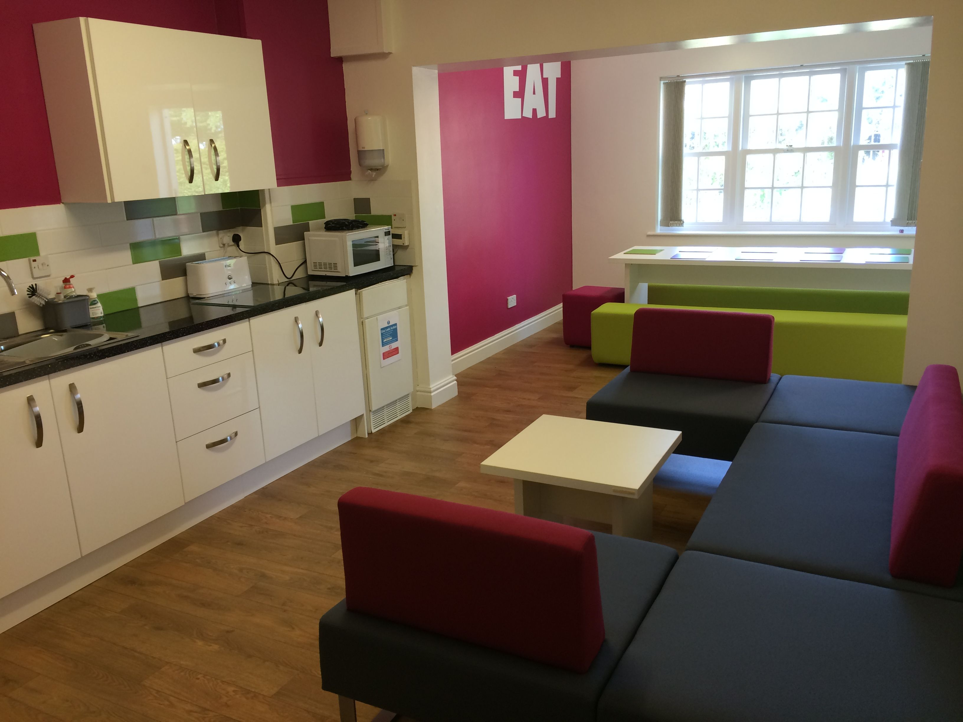 fice Kitchen and breakout area with dining bench upholstered