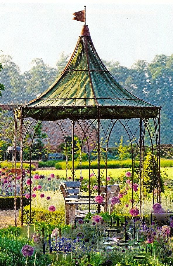 A Circular Metal Structure That Will Patina Nicely As It Ages. Canvas Roof  Lining. This Provides A Spot Of Shade In An Otherwise Sunny Garden.