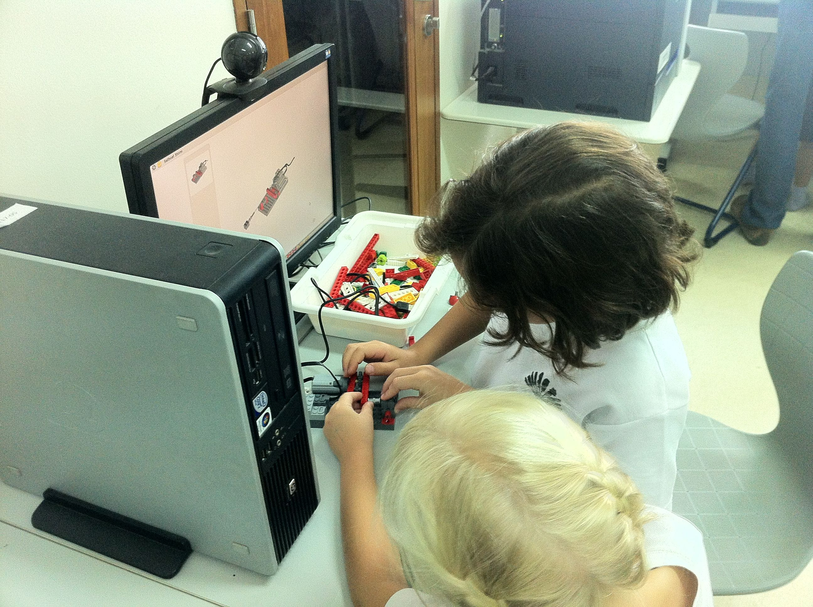 A pair of students sharing one WeDo kit.