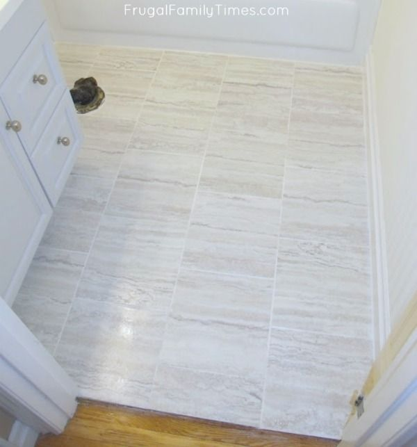How To Grout Peel And Stick Tiles A Cheap And Easy Floor Update Frugal Family Times Peel And Stick Tile Stick On Tiles Flooring