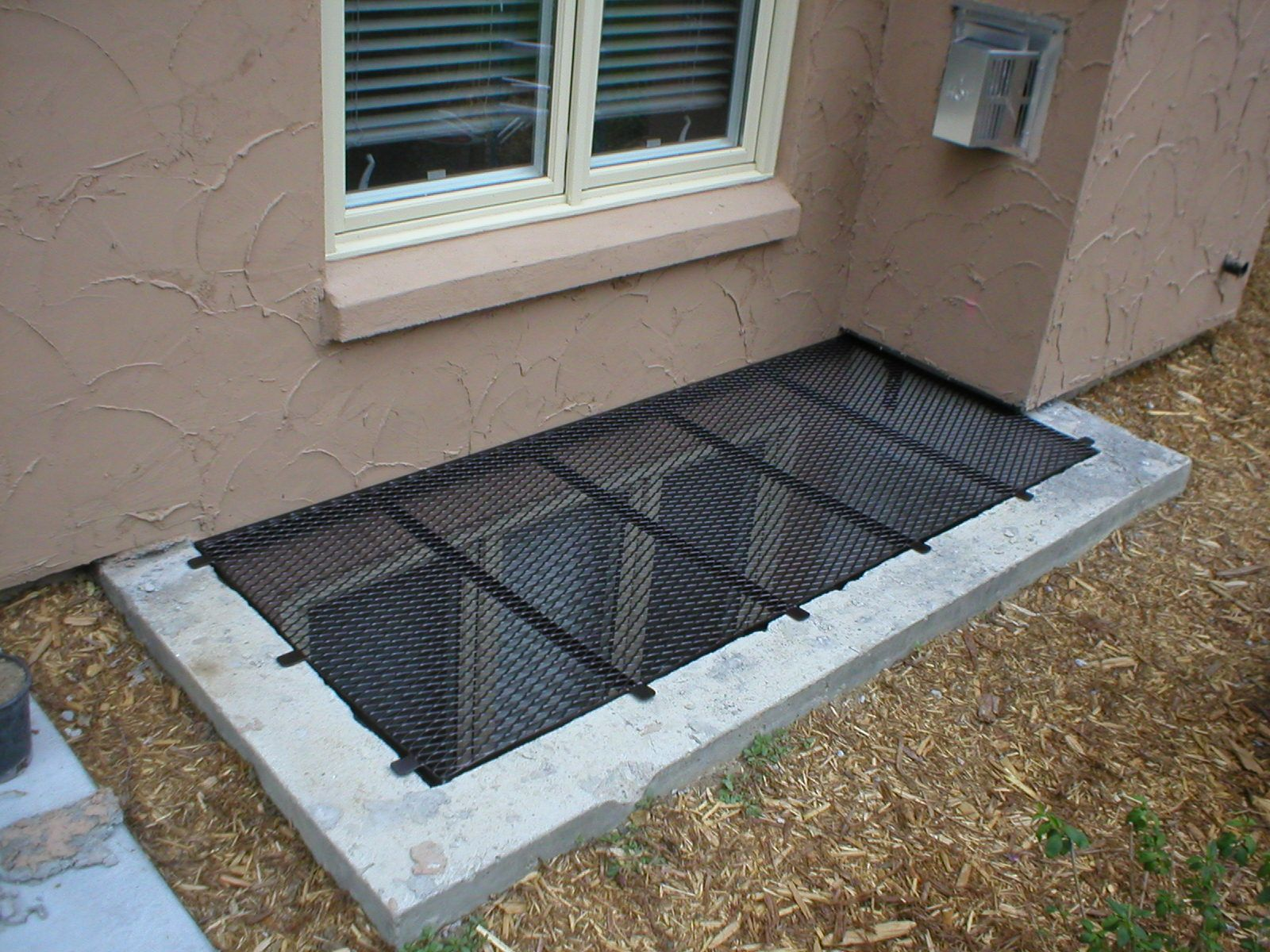 Large Well Cover On Concrete Window Well Window Well Cover Egress Window Well