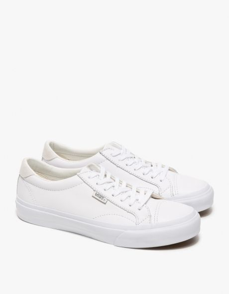 924cfbd2a21 Classic leather lace up sneakers from Vans in True White. Features round  toe