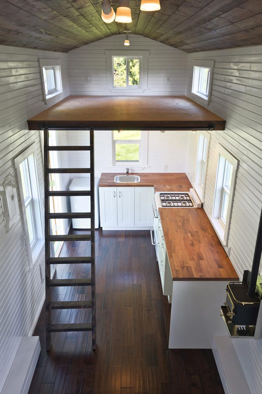 View toward kitchen the alpha tiny home by new frontier tiny homes - Modern Tiny House Interior
