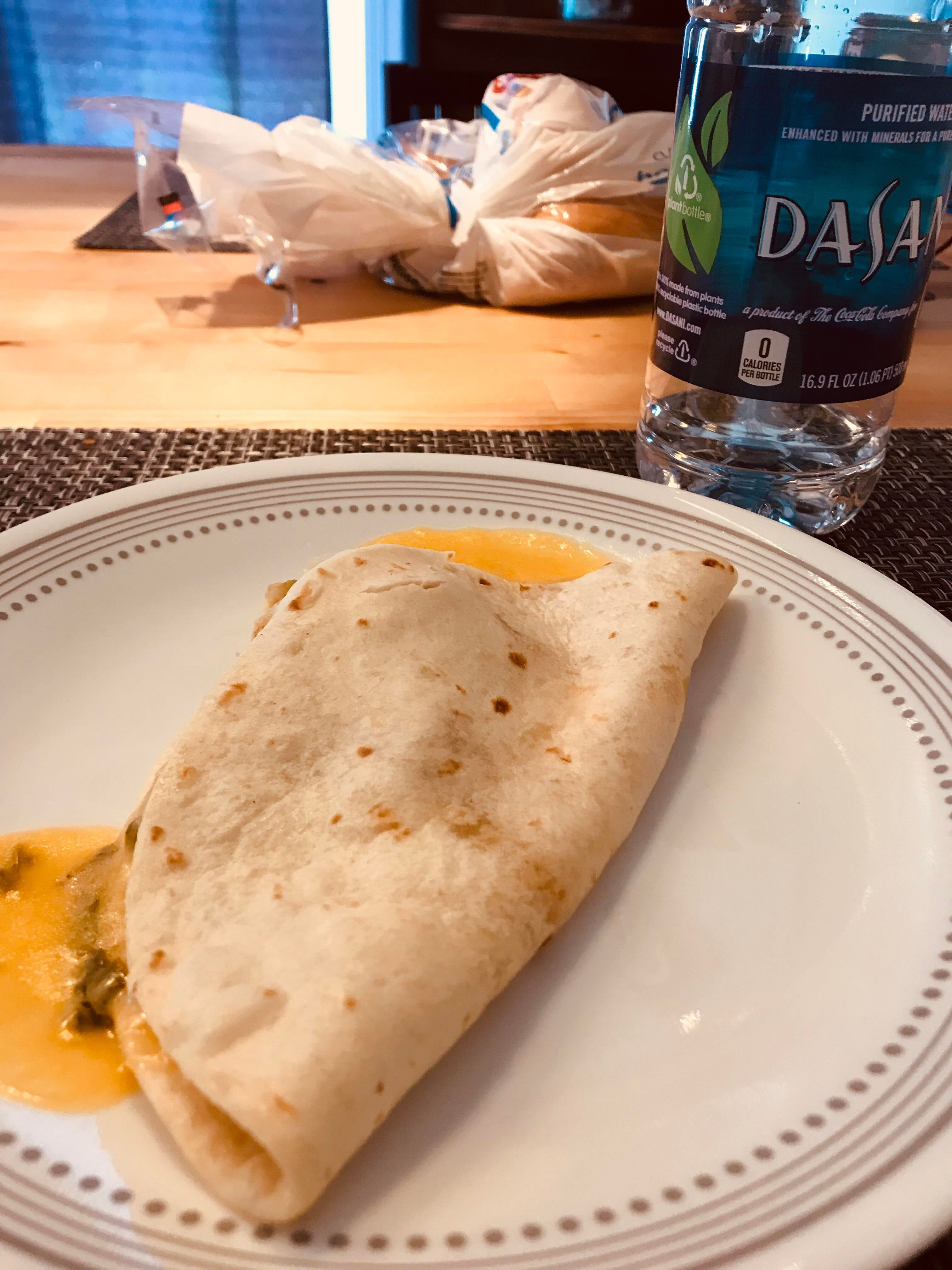 microwaved quesadilla, served with enslaved water