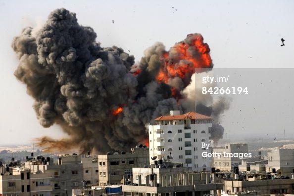News Photo: Flames and debris rise following an Israeli air…