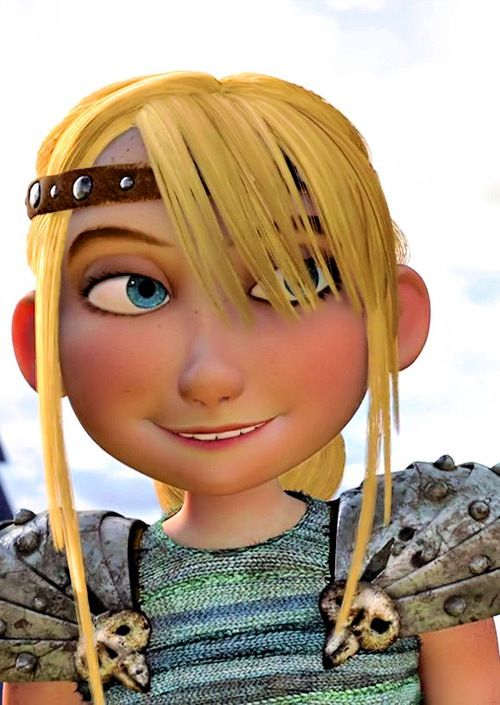 She looks flattered. lol Man I love those eyes, I can see why Hiccup always gets lost in them. lol