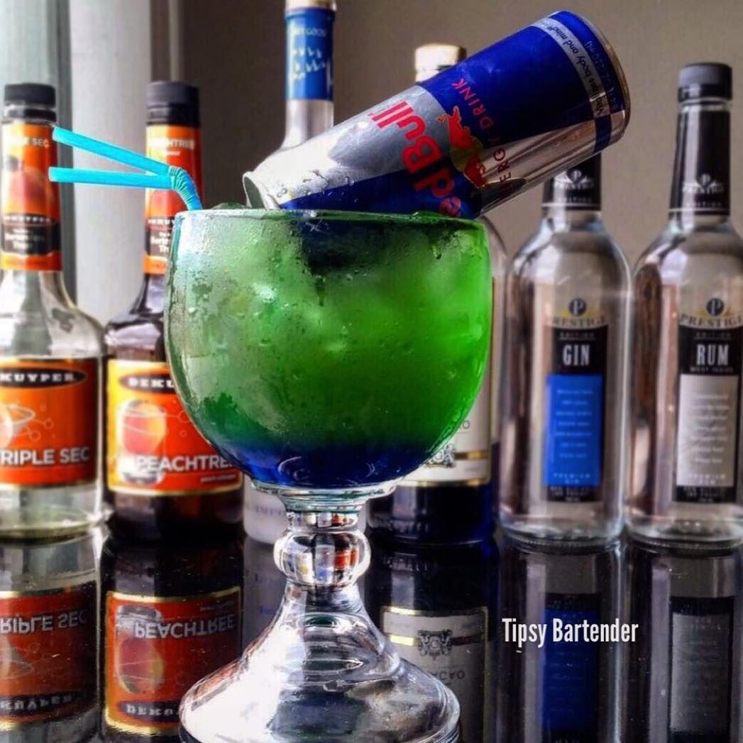 IRISH TRASH CAN 1 oz. (30ml) Blue Curacao 1/2 oz. (15ml) Vodka 1/2 oz. (15ml) Rum  1/2 oz. (15ml) Gin 1/2 oz. (15ml) Triple Sec 1/2 oz. (15ml) Peach Schnapps