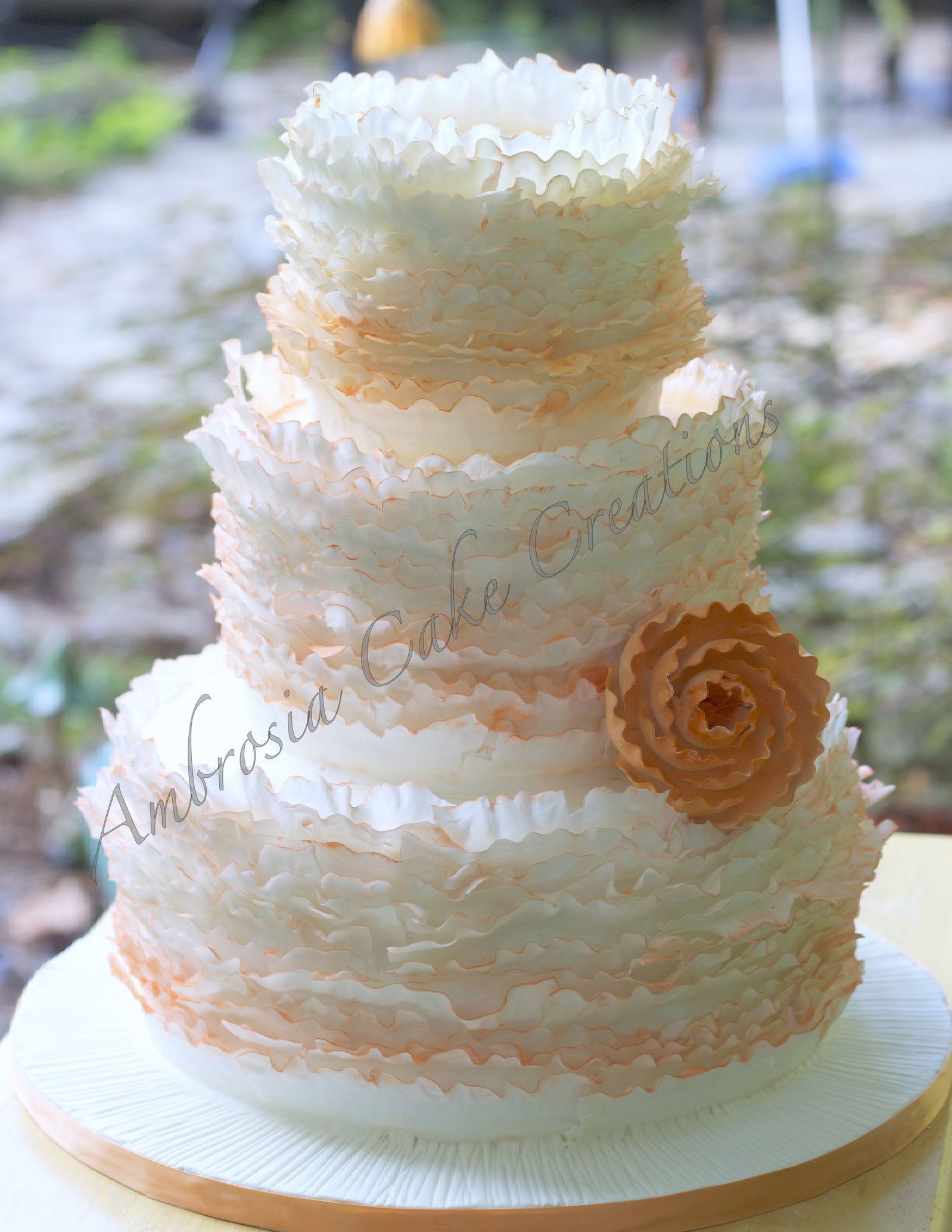 This Romantic Wedding Cake Is Decorated With Paper Thin Ruffles Colored  With An Orange Ombre Effect. The Wedding Took Place In Raleigh, NC.