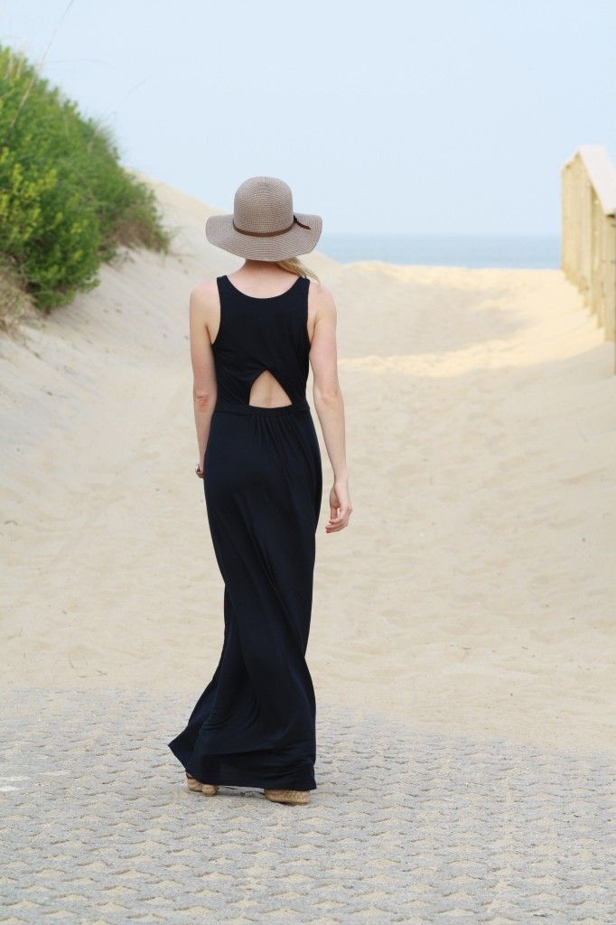 Peekaboo: navy blue cutout back maxi dress, brown floppy straw hat, wedge sandals