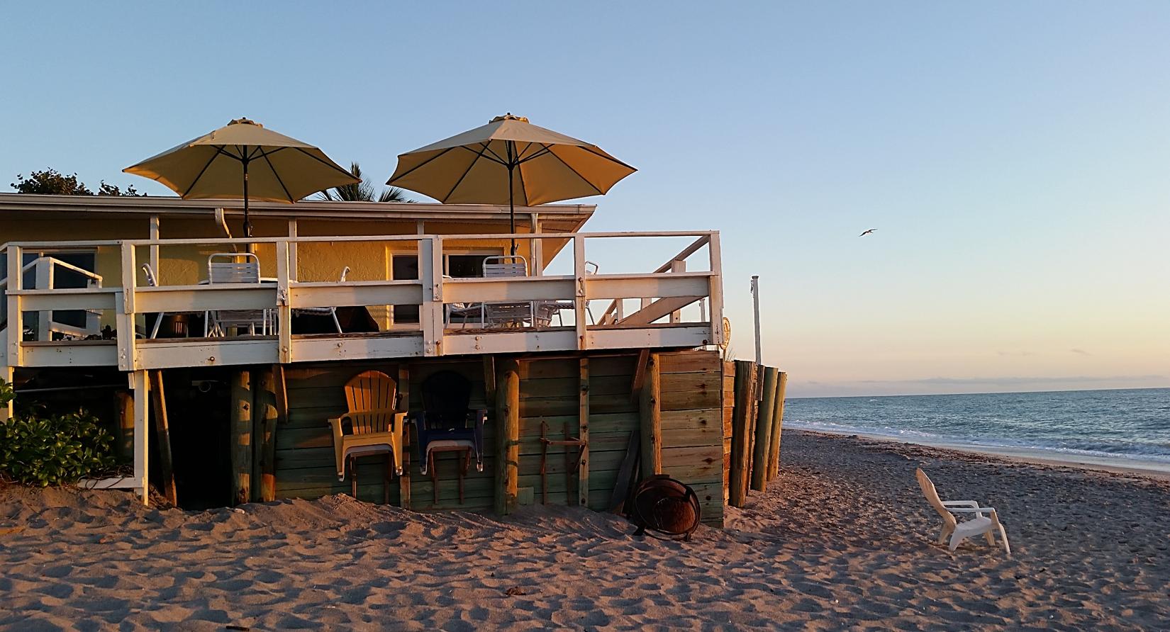 The Pearl Beach Inn at dusk. | Florida hotels, Pearl beach ...