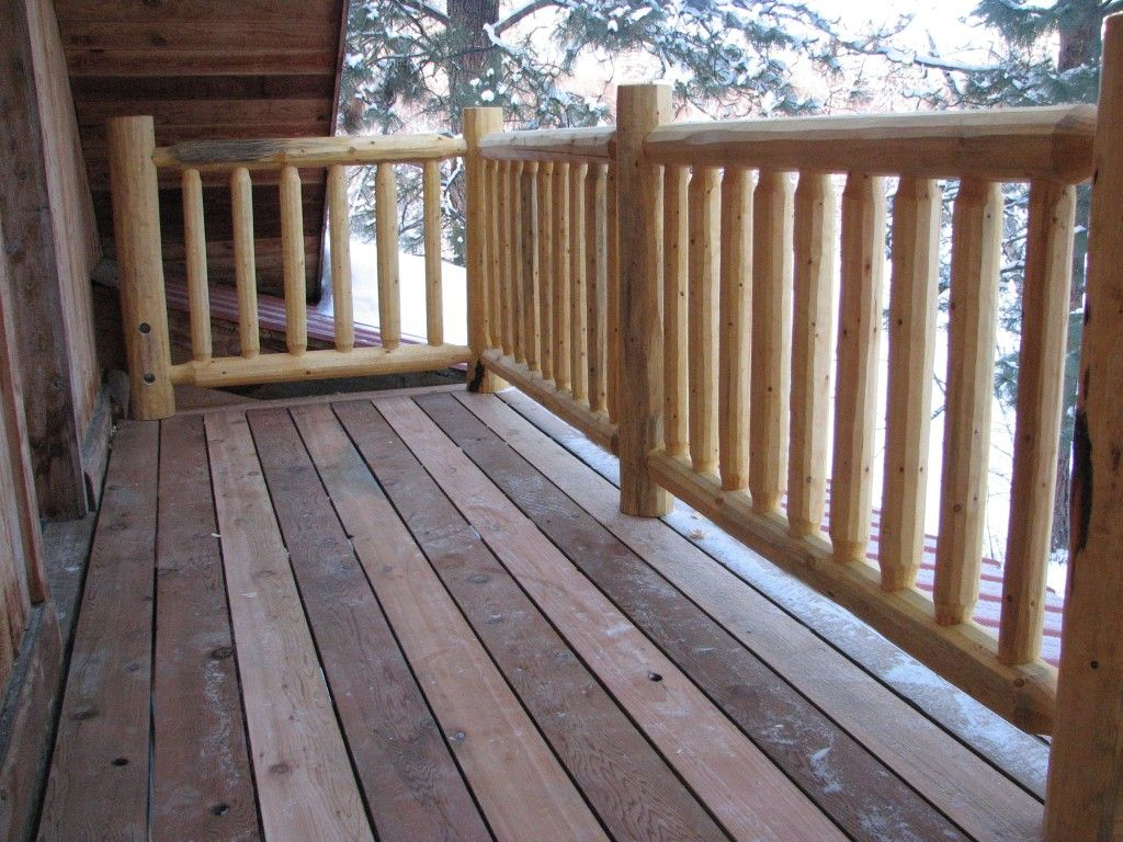 Wood deck railing photos cascade log creations did a for Outside decking material