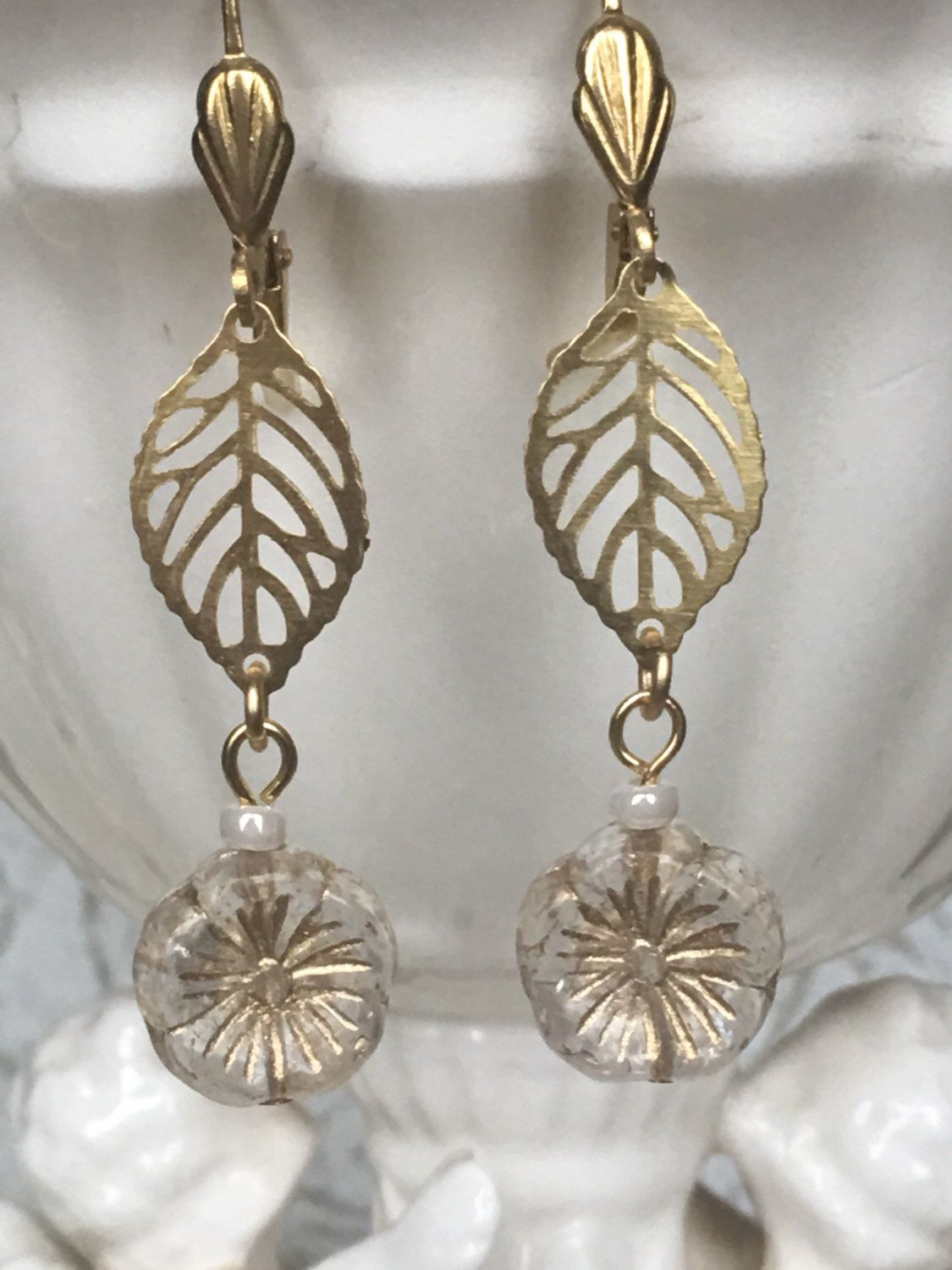 A personal favorite from my Etsy shop https://www.etsy.com/listing/494033755/gold-leaves-flower-czech-glass-drop