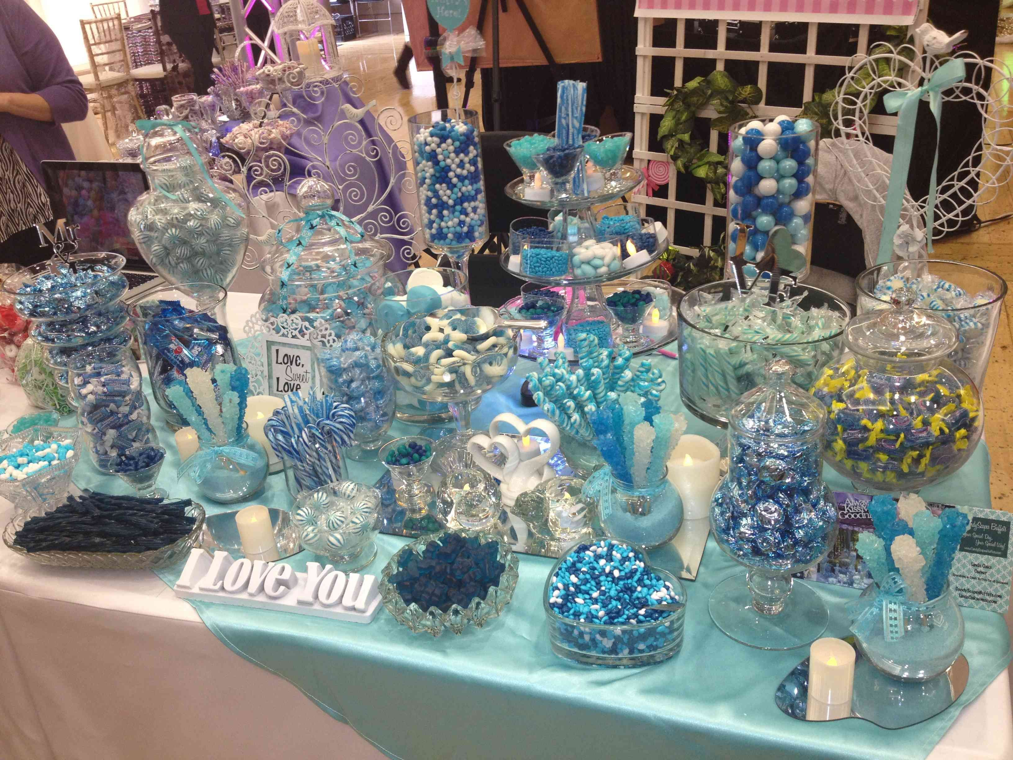 High school graduation centerpieces blue candy table
