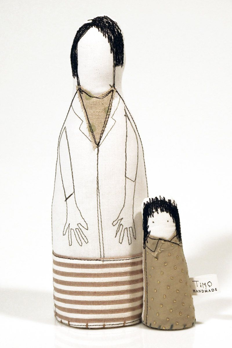 Mother and child - mom in beige striped skirt and dotted green scarf and a little girl in a dress with gold points - handmade fabric dolls. $62.00, via Etsy.