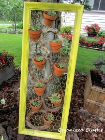 Old frame, chicken wire, horseshoes and pots