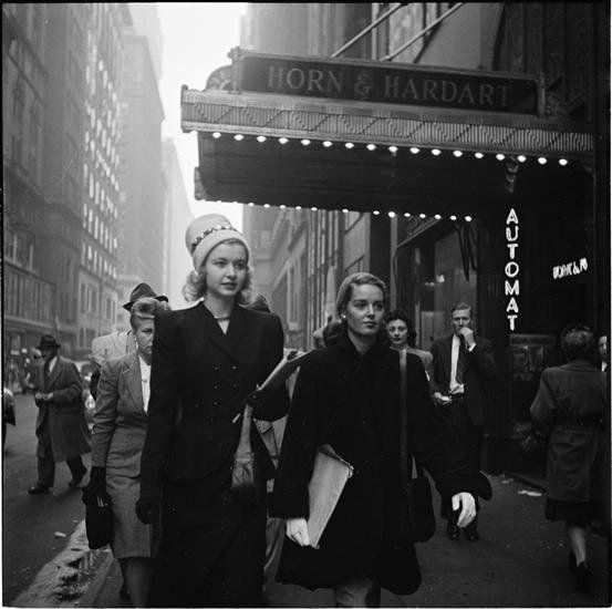 People Mugging [Women walking down the street.]