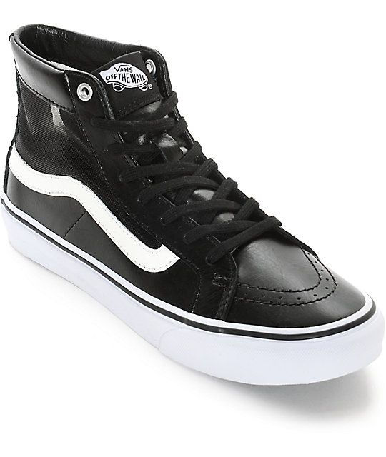 9a61e008630 A sleek black synthetic leather high top upper finished mesh side panels  and white Vans logo detailing offers a modern take on a classic favorite.