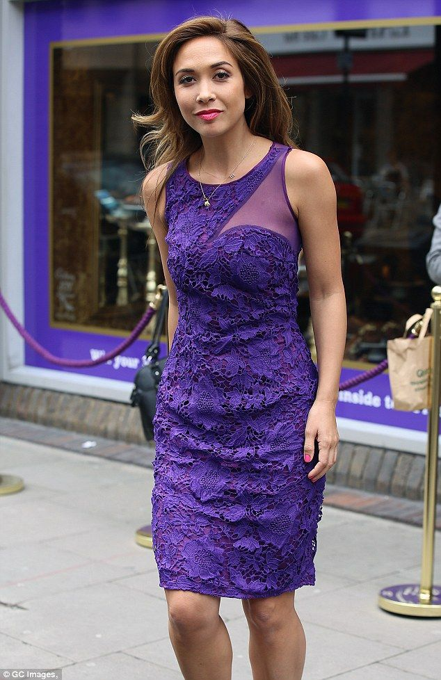 Myleene Klass in tasteful purple lace dress in chocolate shoe shop