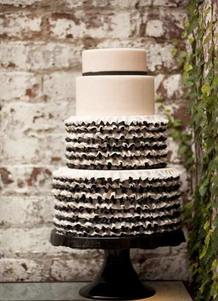 Dusky pinks and black softened with the ruffles equals one very stylish wedding cake