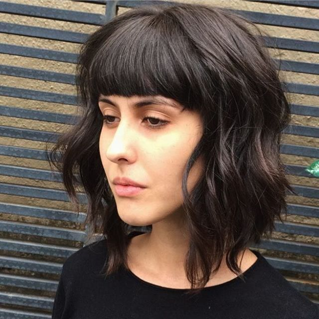 Long Shaggy Brown Bob With Texture Lengths And Full Blunt Bangs The Latest Hairstyles For Men And Women 2020 Hairstyleology Bob Haircut With Bangs Bob Hairstyles Haircuts With Bangs