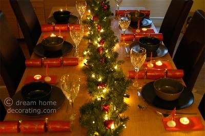 Our Christmas Table With The Garland And Christmas Crackers We
