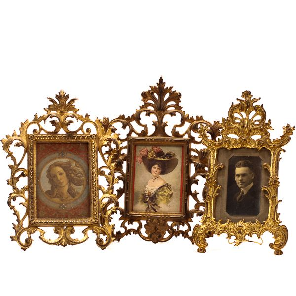 Group of three cast metal antique Victorian stand up picture frames.