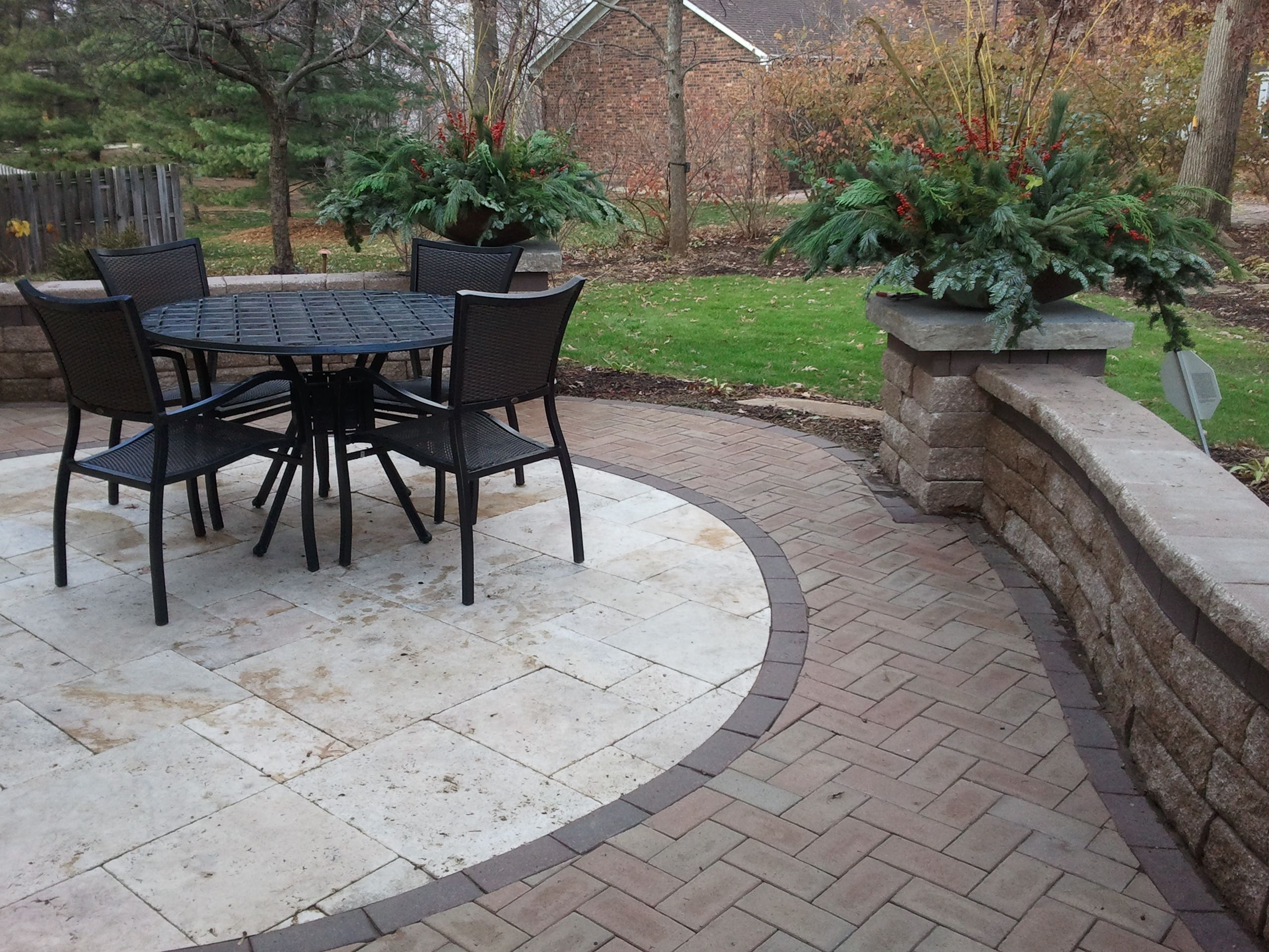 coppertree design travertine patio with clay pavers and sitting