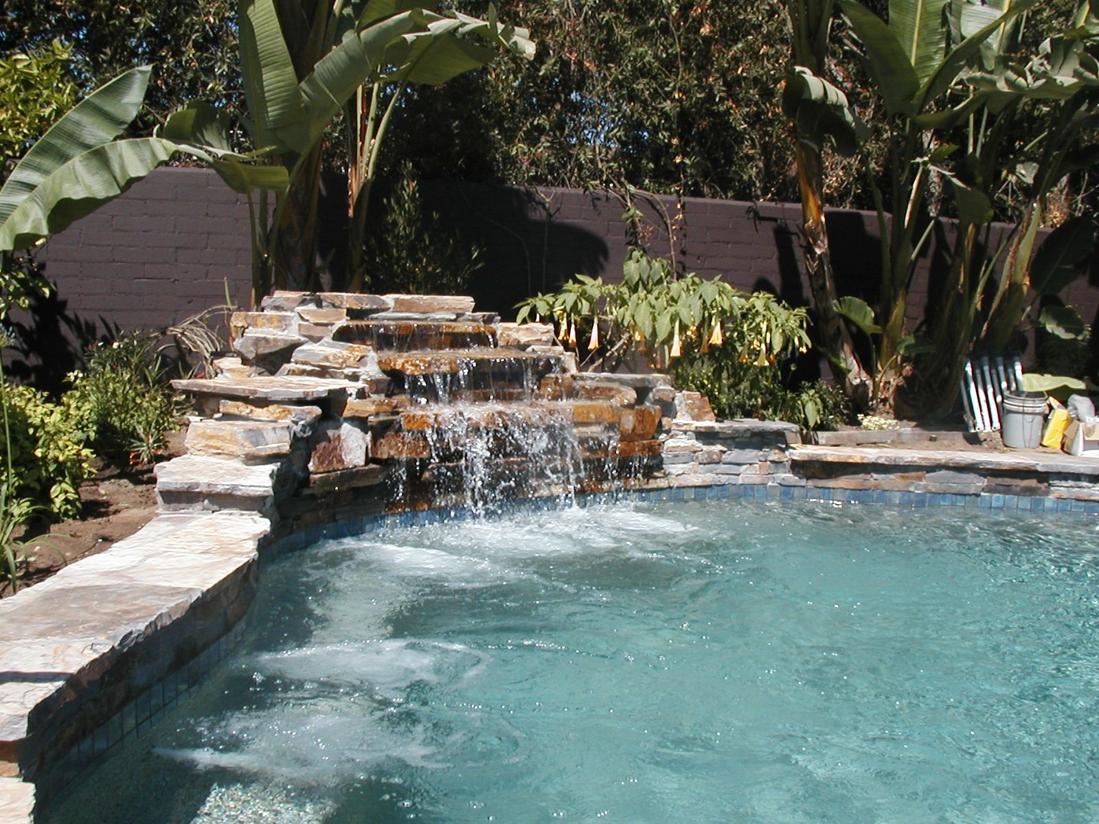Swimming pool with rock waterfall Outdoor renovation