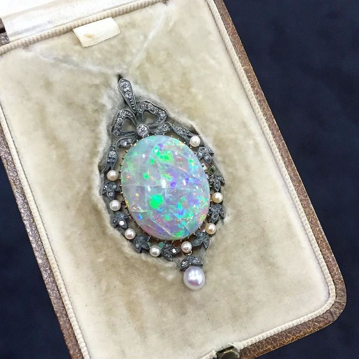 A little opal magic.  #antiquejewelry #OMBAS2016 #OMBAS #opals